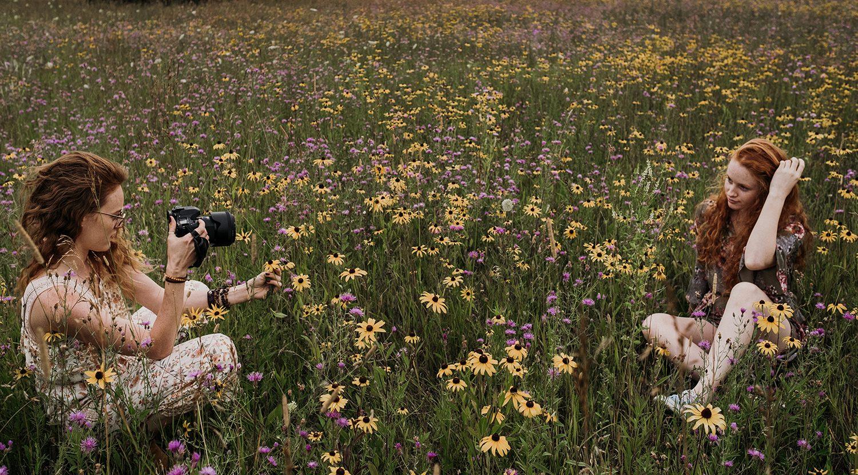 Nicole shooting sister in field of flowers