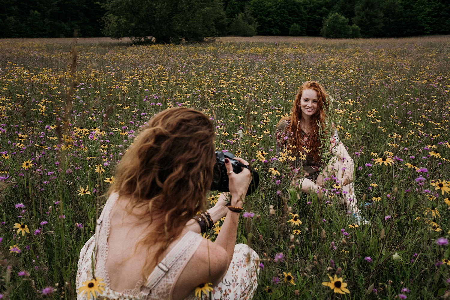 Nicole photographing sister in field of flowers