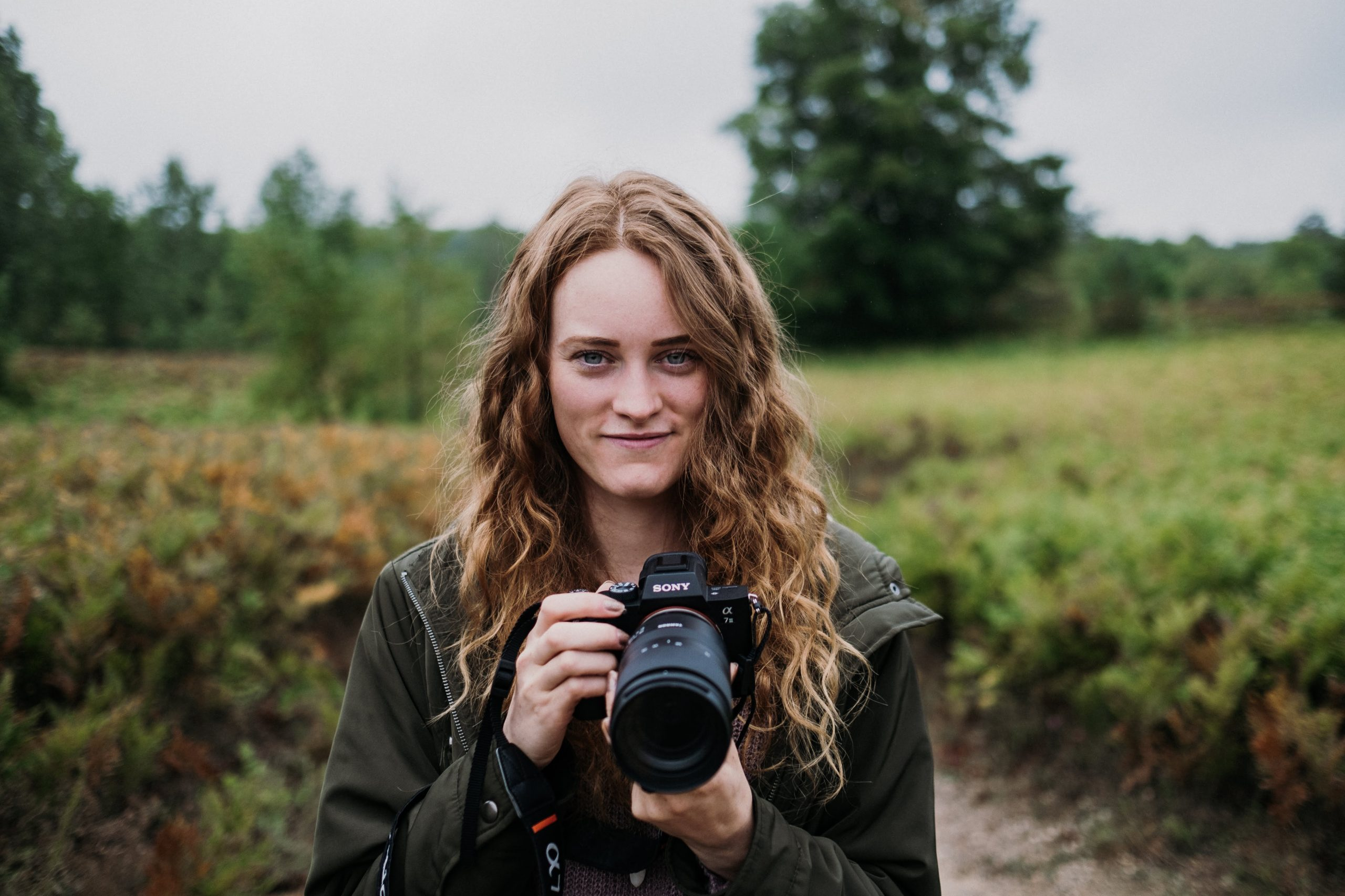 Nicole Geri with sony camera in hands